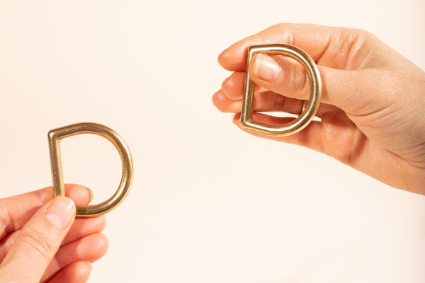 Brass D Rings in Hands