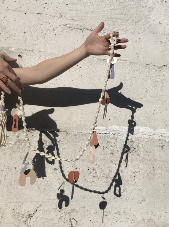 four eyes ceramic chimes in a macrame garland. Ready to ship.