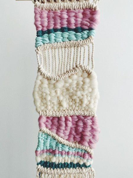 Image of a macra-weave wall hanging.  Learn how to make and design one of your own in our workshop.
