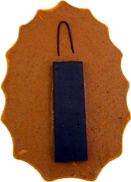 Virgencita clay magnet, back view