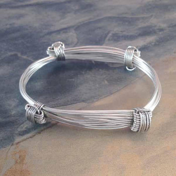 Elephant Hair Knot Bangle in Sterling Silver w/ Story Card