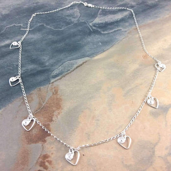 Ndoro and Heart Necklace in Silver