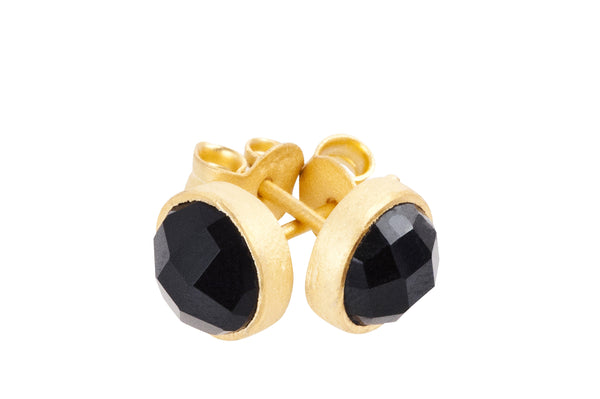 Gold plated silver stud earrings with black onyx gemstone for grounding and a timeless look round with faceted gem