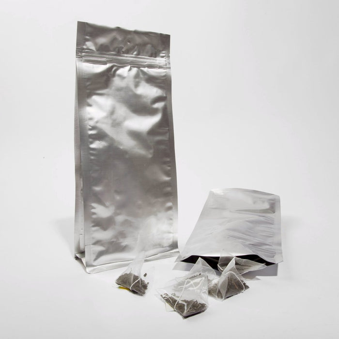 Flat Bottom Bag Clear/ Silver & Full Silver w/ Zip & Tear Notch - Titan Packaging