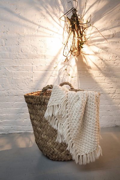 Hand woven basket made of totora reed