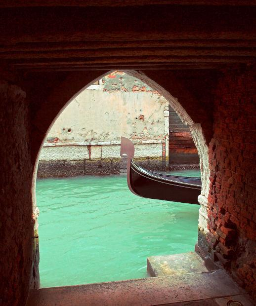 Arch And Passing Gondola, Venice, Italy