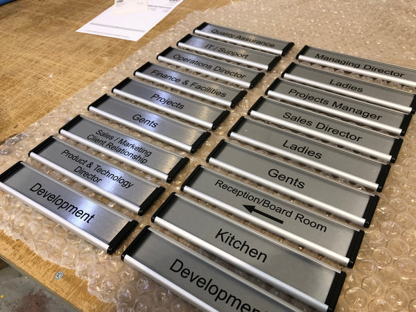 Viro Curve Changeable Door Signs for Warwick International Computing Systems