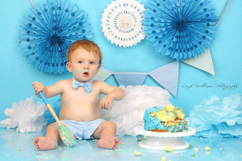 Baby boy bow tie and braces in cake smash birthday photo