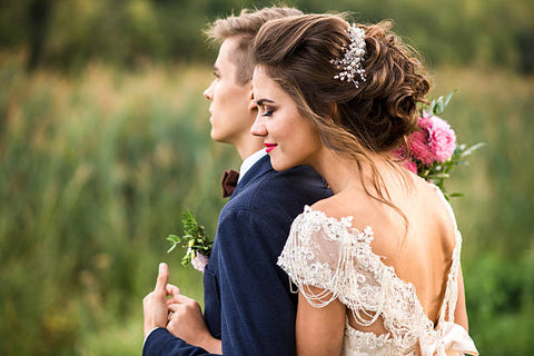 Wedding day ideas.  Bride and Groom in a bow tie and beautiful wedding hair