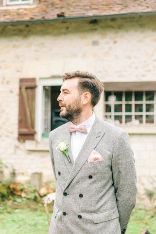 Grey suit and www.dickiebow.co.uk pink bow tie