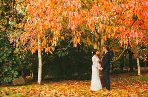 Gorgeous Autumn wedding.  Bride, Groom, tweed, Long sleeved wedding dress.