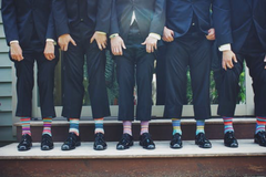 Wedding usher suits and statement socks