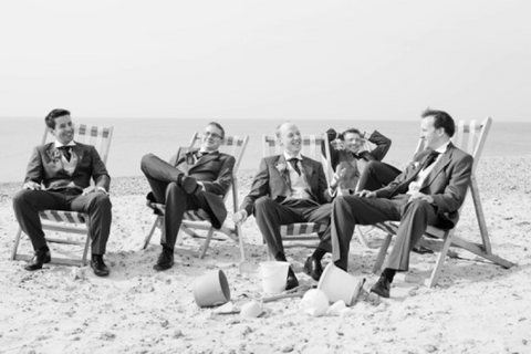 ushers at beach in suits ties pocket square dickie bow wedding blog