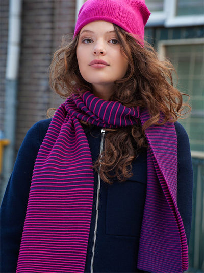 Knitted merino wool scarf with striped gradient pattern. Hot pink and Purple.