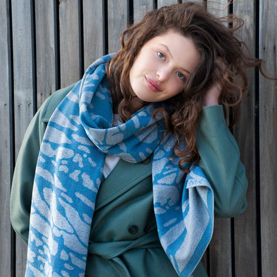 Painted tree scarf has the motif of tree branches and is knitted in the finest Italian merino wool.
