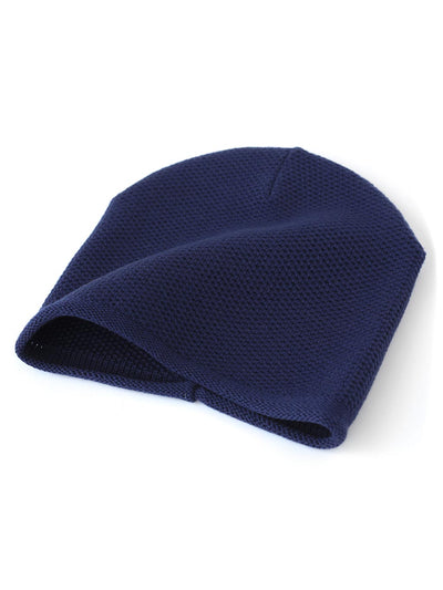 Knit beanie with a grainy texture is knitted in top-quality Italian merino wool. Navy colour.