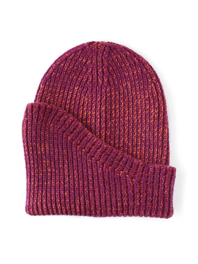 A classic beanie reshaped into a new asymmetrical form, knitted with two colours in premium merino wool. Aubergine and orange colour.