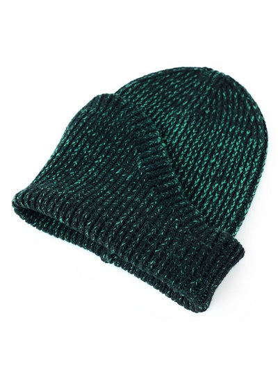 A classic beanie reshaped into a new asymmetrical form, knitted with two colours in premium merino wool. Black and Jade green colour.