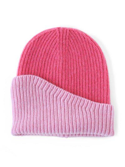 A classic beanie reshaped into a fresh asymmetrical form with a colour block design. Cerise and pink colour.