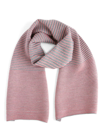 Our soft merino wool scarf has a unique texture with a gradient of knitted ribs. A pink and grey knitted scarf.
