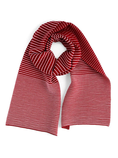 Our soft merino wool scarf has a unique texture with a gradient of knitted ribs. A pink and cherry knitted scarf.