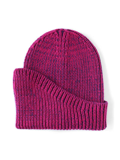 A classic beanie reshaped into a new asymmetrical form, knitted with two colours in premium merino wool. Hot pink and purple colour..