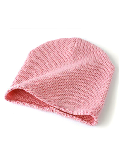 Knit beanie with a grainy texture is knitted in top-quality Italian merino wool. Candy pink colour.