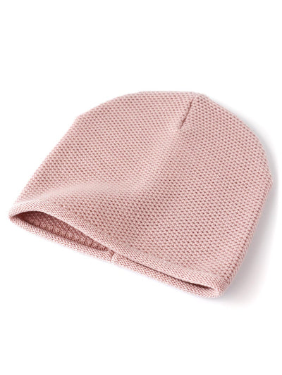 Knit beanie with a grainy texture is knitted in top-quality Italian merino wool. Powder pink colour.