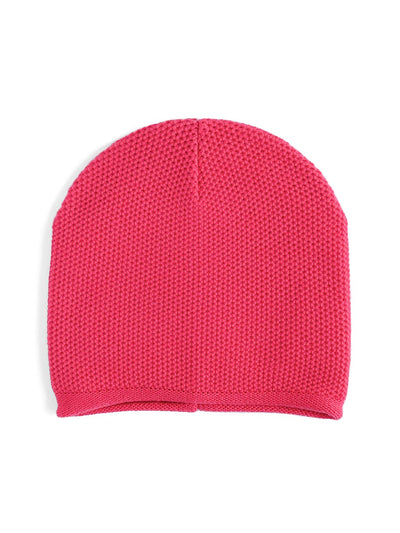 Knit beanie with a grainy texture is knitted in top-quality Italian merino wool. Salmon colour.
