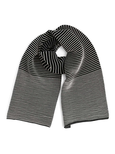 Our soft merino wool scarf has a unique texture with a gradient of knitted ribs. A black and white knitted scarf.