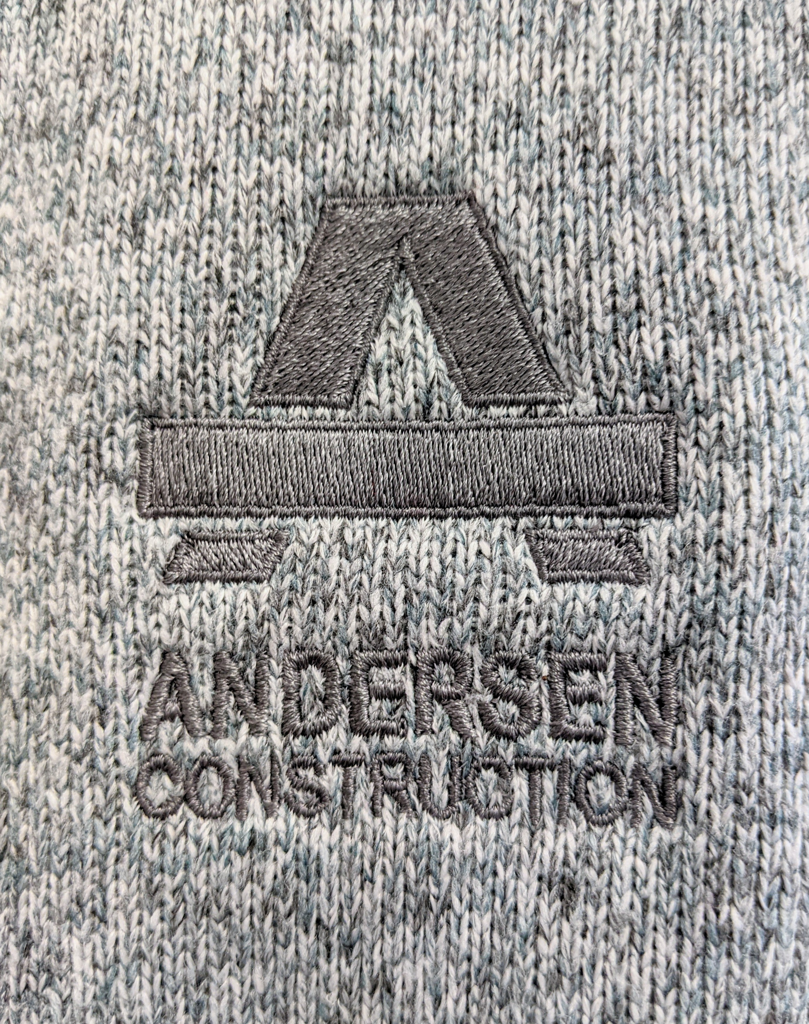 Up-Close View of Embroidered Andersen Construction Logo