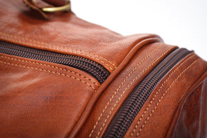 Handmade brown duffel leather travel   gym bag   close up zip
