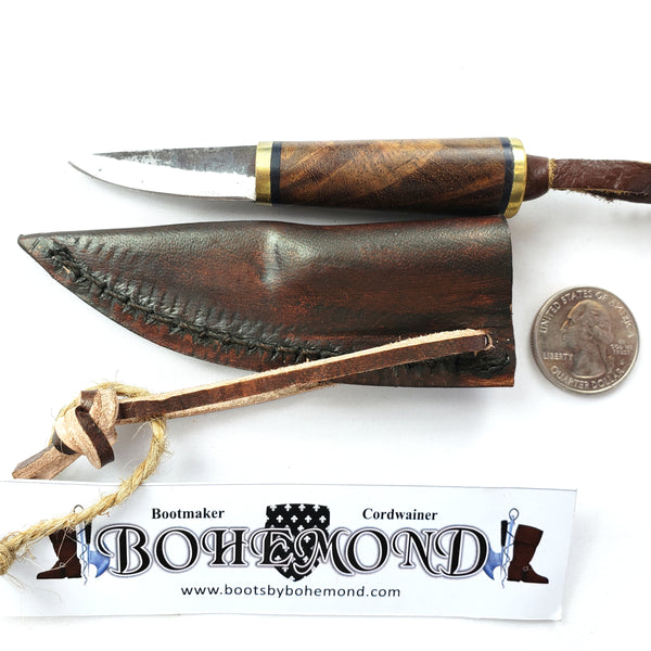 The Fibula Norse Seax is small with tool steel blade Rosewood handle Vegetable-tanned leather sheath.  A great addition to Viking Boob Bling and a Viking belt knife too!