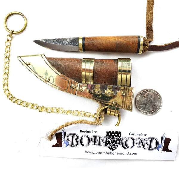 Viking Boob Bling, The Fibula Norse Seax with Chain is a small and robust tool steel blade sturdy and beautiful with a Rosewood handle with brass.   Decorated vegetable tanned leather sheath with Norse Viking brass and silver historical ornamentation