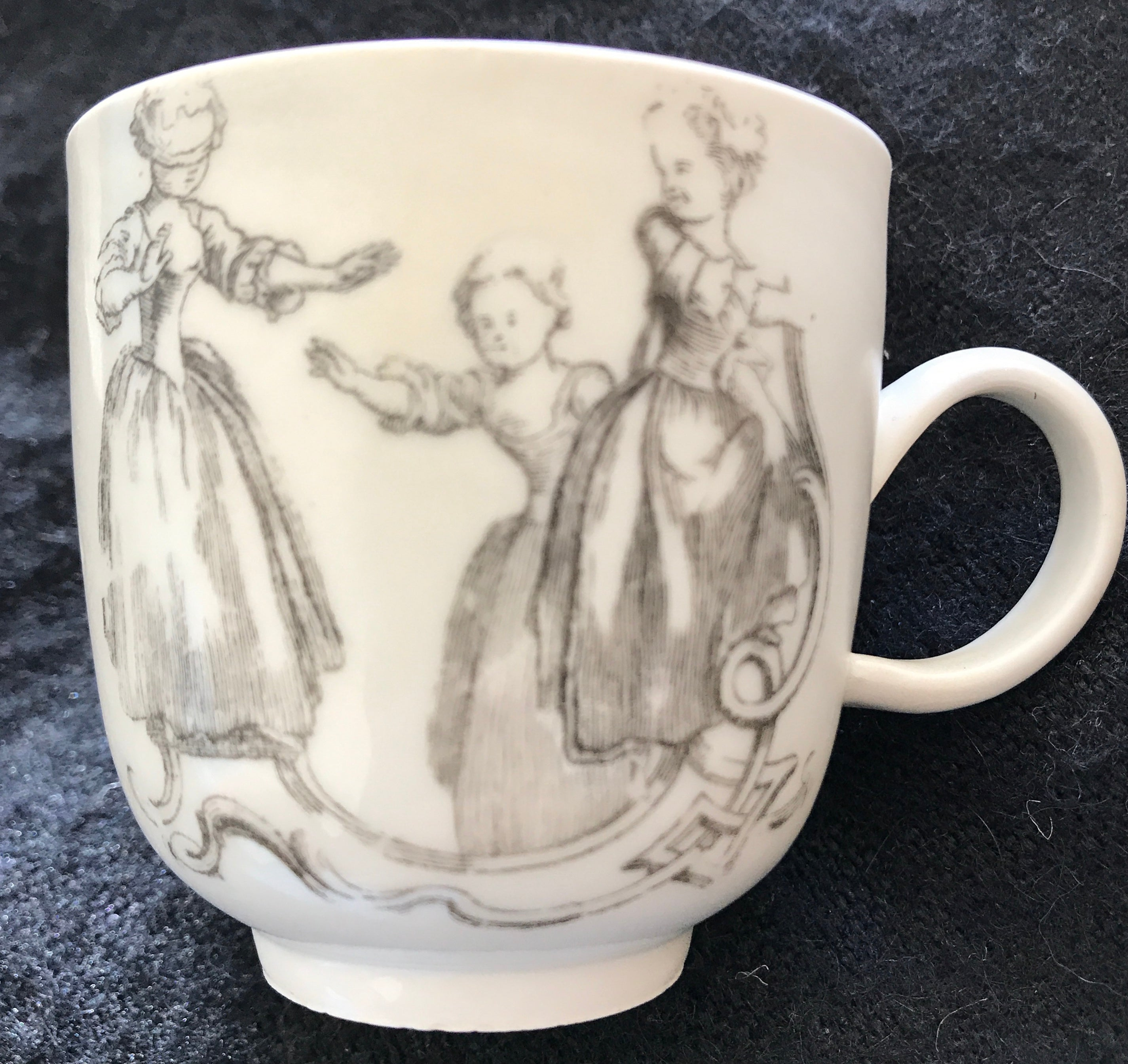18th Century Bristol Porcelain Coffee Cup Transfer Printed after Robert Hancock.