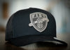 Subdued Forward Observer Fist Shield Trucker Hat
