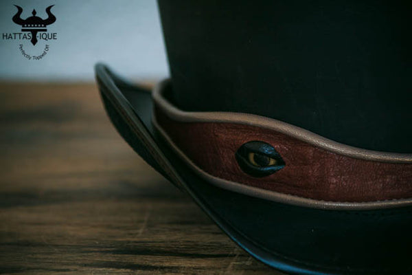 Steampunk hatter kraken eyeball hatband close up on coachman top hat