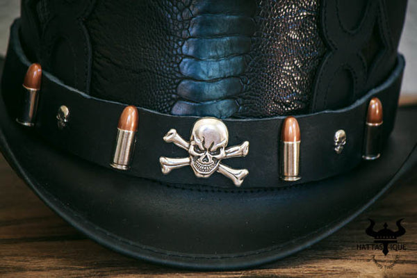 close up view on pirate skull on the caliber top hat