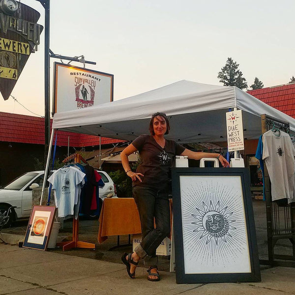 Due West Press selling T-Shirts outside of Sun Valley Brewery in Hailey, ID