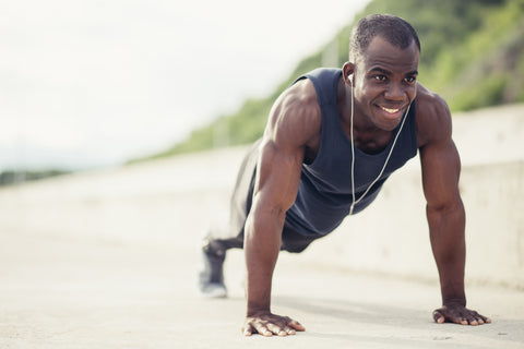 Man doing pushups for an outside workout