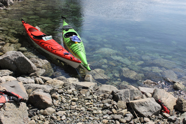 Kayaks coupled using one sea anchor