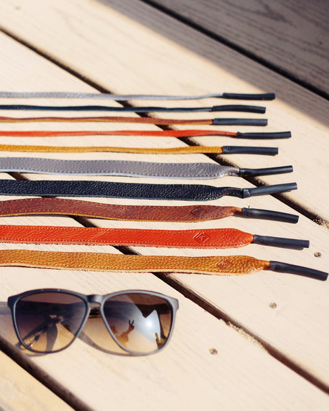 How sunglasses straps and a leather camera strap can keep your stuff safe.