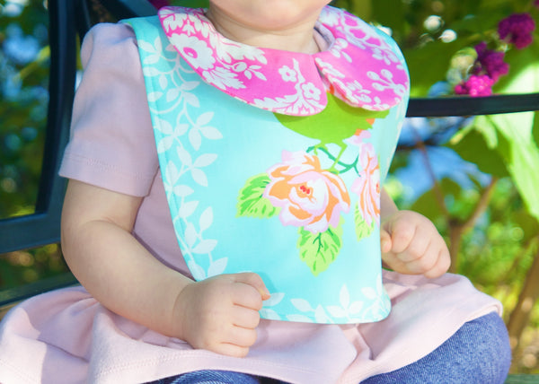 The collared bib: floral mockingbird