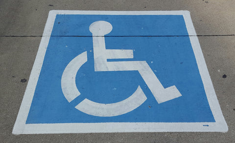 Accessible parking space displaying Blue & White International Symbol of Accessibility
