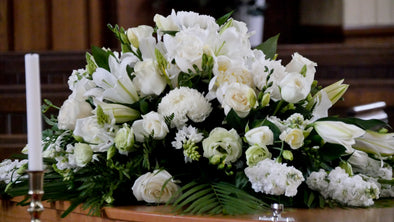 Stunning Casket Spray in Whites & Greens