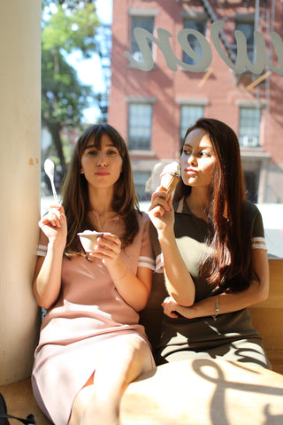 Two girls wearing Petite Studio's nolita polo dress in khaki and pink at van leeuwen artisan ice cream shop