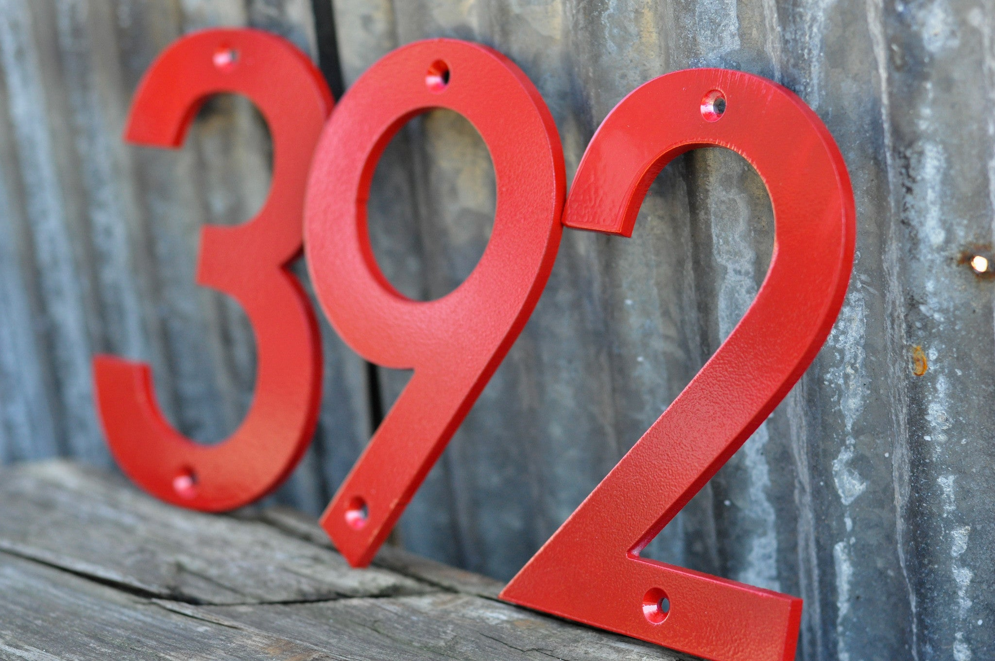 Red powder coated aluminum numbers