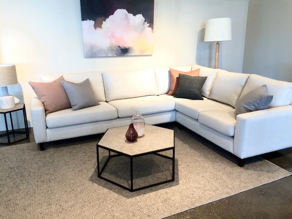 Jasper modular sofa in white with soft grey and terracotta cushions
