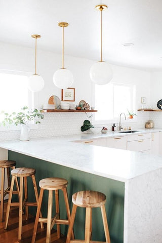 White kitchen with wooden barstools