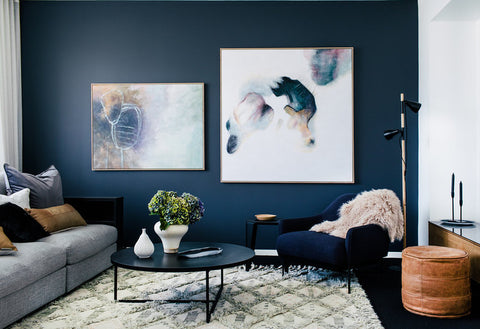 Living Room With White Curtains, Grey Sofa, Navy Blue Wall With 2 Paintings,
